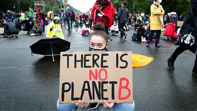 Young people attend a 'Fridays For Future' protest rally at the Brandenburg Gate in Berlin.