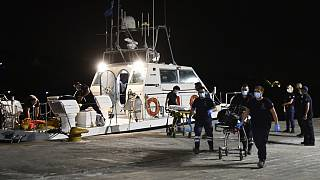 A coast guard vessel arrives with two bodies at Pythagorio port, on the eastern Aegean island of Samos