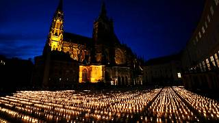 Candles are lit to commemorate victims of the COVD-19 pandemic at the Prague Castle in Prague, Czech Republic, Monday, May 10, 2021