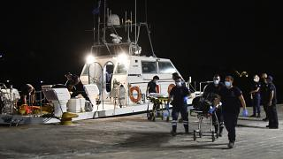 A coast guard vessel arrives with two bodies at Pythagorio port, on the eastern Aegean island of Samos.