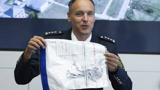 Police spokesman Thomas Geithner shows the remains of the metal foil of the balloon.