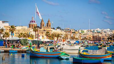 Malta port with multiple boats in the harbour