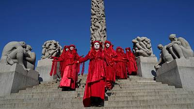 A Red Rebels brigade of the XR-Nordic Rebellion group stage a protest for the climate and against oil extraction in Norway in the Vigeland Park in Oslo on August 23, 2021.