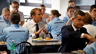 French President Emmanuel Macron and French Interior Minister Gerald Darmanin, right, have lunch with Gendarmes at the Roubaix police academy, northern France, Sept. 14, 2021.