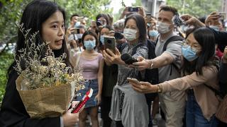 Zhou Xiaoxuan, a former intern at China's state broadcaster CCTV, speaks outside a courthouse on Sept. 14, 2021.