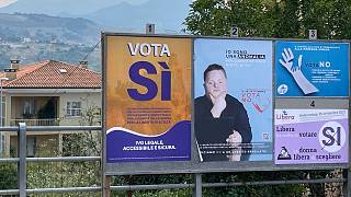 A view shows pro and anti-abortion campaign posters on September 10, 2021 in San Marino