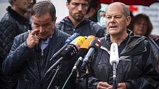 In this Tuesday, Aug.3, 2021 file photo Armin Laschet and Olaf Scholz ddress the media during a press conference in Stolberg, Germany that was hit by heavy rain and floods.