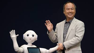 Softbank boss Masayoshi Son and Pepper the robot in 2014