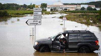 A driver looks at the water flooding a road in Aigues, in the Gard department, in the Occitanie region, southern France, on September 14, 2021 following heavy rains.