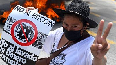 A demonstrator protests Bitcoin in San Salvador on Wednesday
