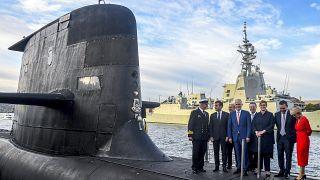 French President Emmanuel Macron (2/L) and then Australian Prime Minister Malcolm Turnbull (C) on HMAS Waller, an Australian Royal Navy submarine, Sydney, May 2, 2018.