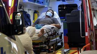 A man lays in an ambulance at the emergency service of the hospital in Papeete, Tahiti island, French Polynesia, Aug.20, 2021.