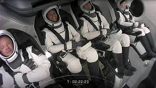 This screengrab taken from the SpaceX live webcast shows crew members.