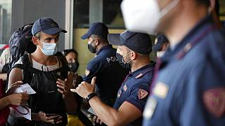 olice officers check passenger's documents at the entrance of Porta Garibaldi train station, in Milan, Italy, Wednesday, Sept. 1, 2021