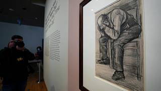 """A photographer takes pictures of Study for """"Worn Out"""", a drawing by Dutch master Vincent van Gogh, at the Van Gogh Museum in Amsterdam, Netherlands, Sept. 16, 2021."""