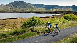 A pair cycles along the Great Western Greenway in Mayo.