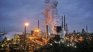 a ThyssenKrupp coking plant steams around the clock for the nearby steel mill in Duisburg, Germany.