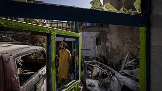 An Afghan inspects the damage of Ahmadi family house in Kabul, Afghanistan, Monday, Sept. 13, 2021.