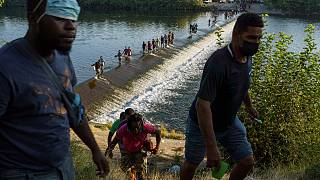 Haitianer überqueren den Rio Grande