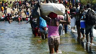 Haitian migrants use a dam to cross to and from the United States from Mexico, in Del Rio, Texas.
