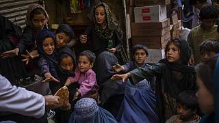 Afghan women in a bread queue in Kabul's old city