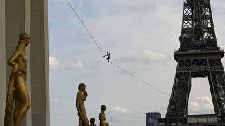 French acrobat Nathan Paulin attempts to walk a highline from the Eiffel Tower across the Seine River.