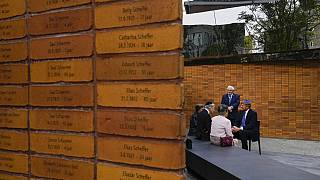 King Willem-Alexander, right, talks to Holocaust survivors and relatives after unveiling the new monument in Amsterdam's historic Jewish Quarter