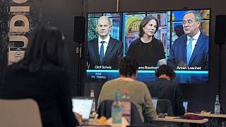 German general election candidates Olaf Scholz, left, Annalena Baerbock, center, and Armin Laschet, right, in a televised debate - Sunday Sept. 19, 2021