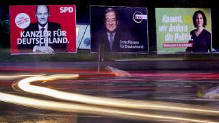 Three elections posters show candidates for chancellor in the German election.