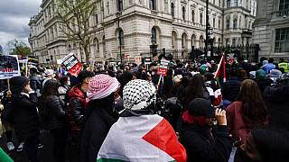 People gather outside Downing Street to protest against Israeli attacks on Palestinians in Gaza, in London, Saturday, May 15, 2021