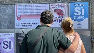 People view pro and anti-abortion campaign posters on September 10, 2021 in San Marino at the start of the referendum campaign