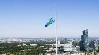 A Kazakhstan national flag flies at half staff over Almaty.