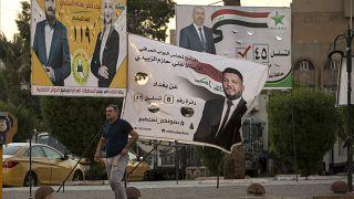ملصقات لمرشحين إلى الانتخابات في بغداد