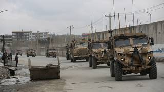 British troops with NATO-led Resolute Support Mission forces travel, in Kabul, Afghanistan, on March 25, 2020.