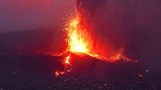 Lava from a volcano eruption flows on the island of La Palma in the Canaries, Spain, Tuesday, Sept. 21, 2021