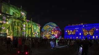 "People gather on Bebelplatz for the ""Festival of Lights"" in Berlin, September, 2021."