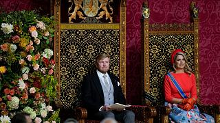 Queen Maxima listens as Dutch King Willem-Alexander marks the opening of the parliamentary year.