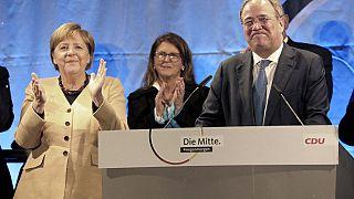 Angela Merkel abucheada  a pocos días de las elecciones federales