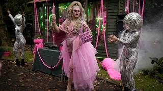 Daisy the Drag Queen Gardener performs at the Chelsea RHS Flower Show in London, Monday, Sept. 20, 2021.