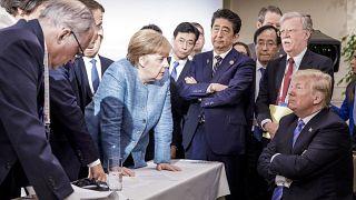 Angela Merkel se dirige a Donald Trump en una imagen emblemática de la reunión del G7 de junio de 2018 en Québec, Canadá.