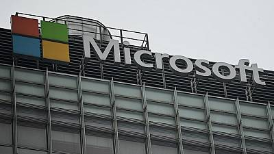 The Microsoft logo is seen at its local headquarters in Beijing on July 20, 2021.