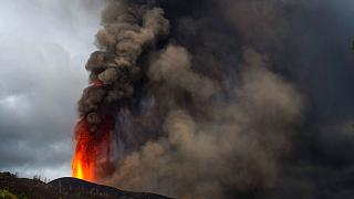 Lava and ashes from a volcano eruption flow on the island of La Palma in the Canaries, Spain, Wednesday, Sept. 22, 2021