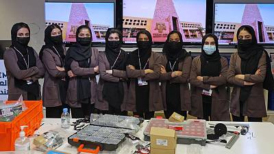 Members of an all-girl Afghan robotics team pose for a picture at the laboratory of Qatar's Texas A&M university in the capital Doha
