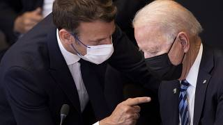 FILE - In this June 14, 2021 file photo, US President Joe Biden, right, speaks with French President Emmanuel Macron during a plenary session during a NATO summit.