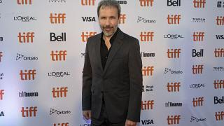 "Director Denis Villeneuve walks the red carpet as he promotes his film ""Dune"" during the Toronto International Film Festival, on Saturday, Sept. 11, 2021, in Toronto"