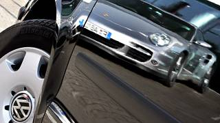 Oct 27, 2007 file picture shows a Porsche sports car. reflected in the door of a Volkswagen compact car in Frankfurt, Germany.
