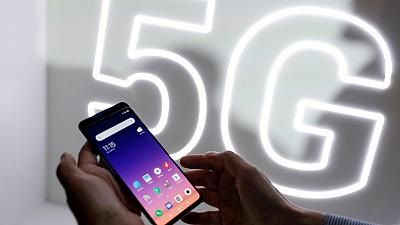 A person checks out the Xiaomi Mi 9 mobile phone ahead of the Mobile World Congress (MWC 19) in Barcelona, Spain, February 24, 2019.