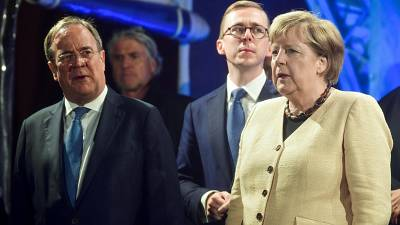 German Chancellor Angela Merkel attends an election rally with Christian Democratic Union (CDU) leader, Armin Laschet in September 2021