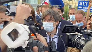 Catalan leader Carles Puigdemont, leaves the jail of Sassari, in Sardinia, Italy, on Friday.