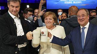 Markus Söder, Angela Merkel und Armin Laschet in München